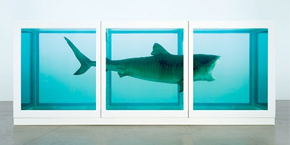 The Physical Impossibility of Death in the Mind of Someone Living, a 14-foot (4.3 m) tiger shark immersed in formaldehyde, by Damien Hirst